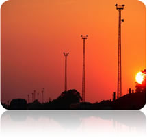 communications towers sunset